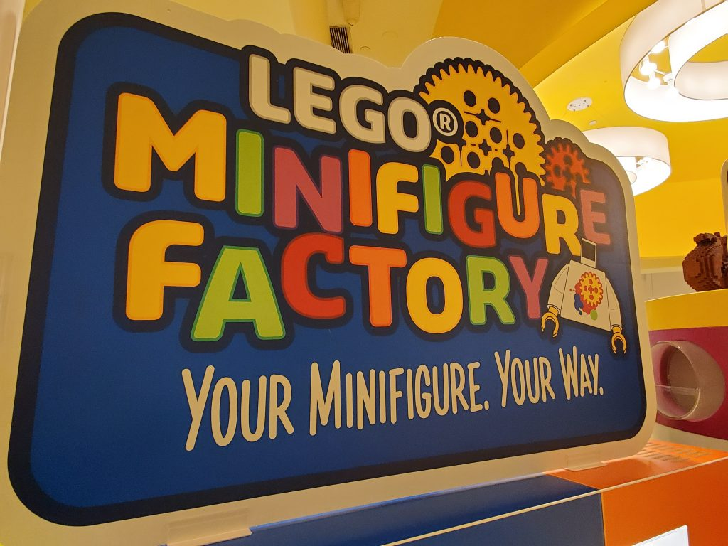 Sign for the Lego Minifigure Factory in Disney Springs.